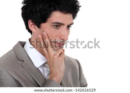 A pensive businessman. - stock photo
