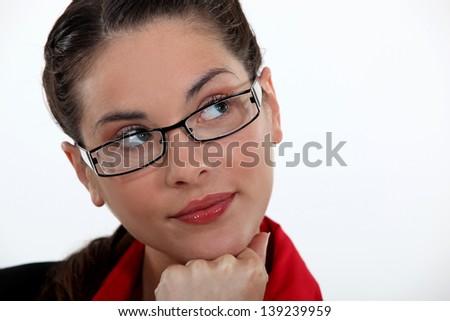 A pensive businesswoman. - stock photo