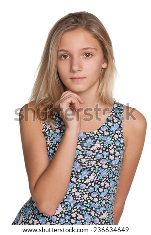 A pensive preteen girl on the white background - stock photo