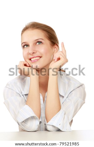 A pensive young woman at the desk, isolated on white - stock photo