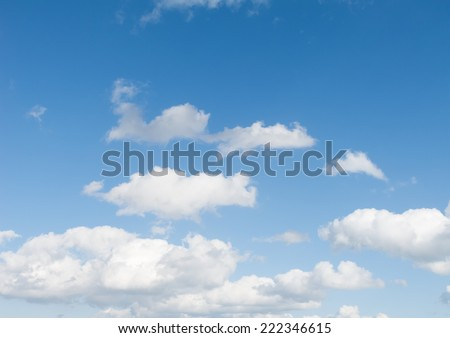 A perfect blue Summer sky, with small white clouds - stock photo
