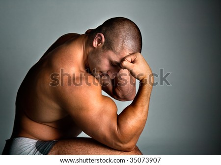 A perfect muscular man posing artistic, studio shot - stock photo