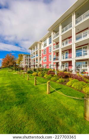 A perfect neighborhood. Apartments in suburb at Fall in the north America. - stock photo