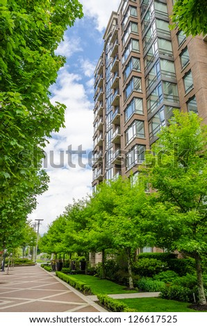A perfect neighborhood. apartments in suburb at Spring in the north America - stock photo
