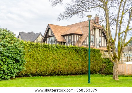 A perfect neighborhood. Houses in suburb at Spring in the north America. Overcast. Clouds. - stock photo