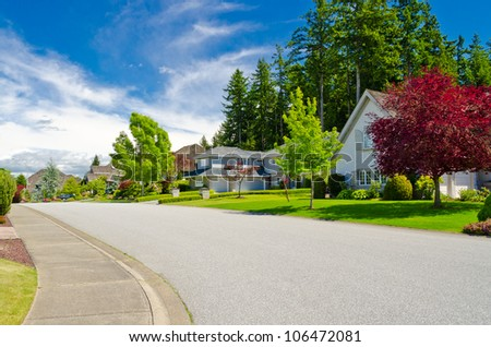A perfect neighborhood. Houses in suburb at Summer in the north America - stock photo