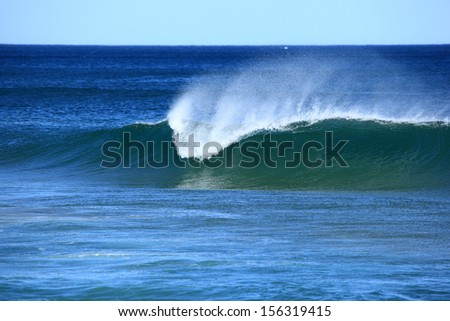A perfect wave breaking at the beach.