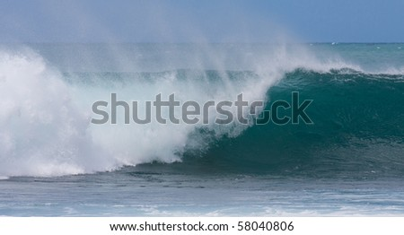 A perfect wave for surfing on beautiful Hawaii Oahu's North Shore - stock photo