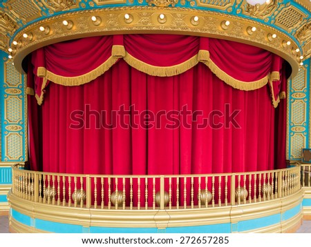 A performance Stage with red curtain and railing in amusment park - stock photo