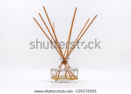 a perfumer with wood sticks