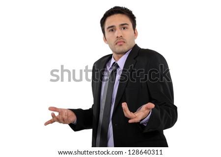 A perplexed businessman - stock photo