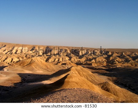 a person at the Negev desert in Israel at the sunset - stock photo