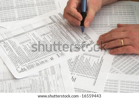 A person attempting to do his taxes. - stock photo