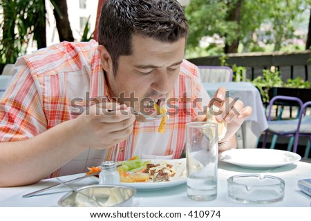 A person having a meal in a restaurant - stock photo