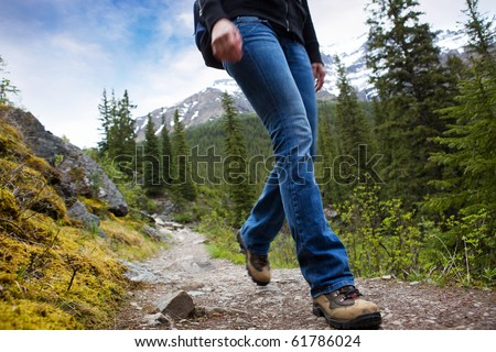 A person hiking in Banff National Park, Alberta, Canada - stock photo