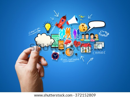 A person holding various creative and lifestyle elements. - stock photo