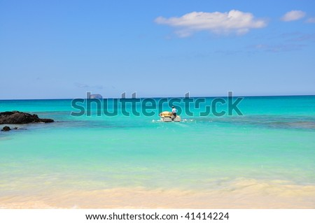 A person in a Speed boat Galapagos Islands - stock photo