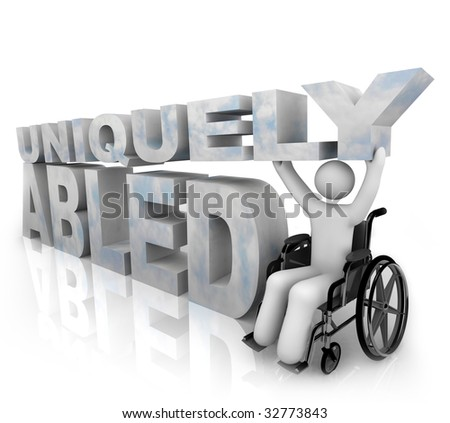 A person in a wheelchair beside the words Uniquely Abled - stock photo