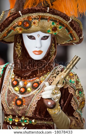 A person in costume holding a pistol at the Venice Carnival