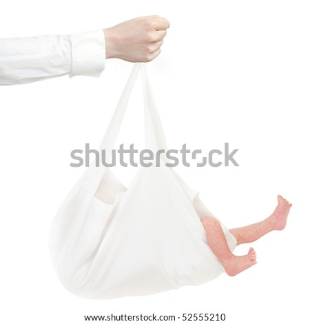 A person is holding a white cloth bag with a baby in his hands. The baby is sticking its feet out of the bag. - stock photo