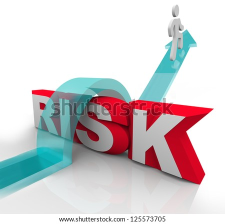 A person jumps over the word Risk to symbolzine avoiding danger or hazards and being careful and prepared to overcome dangerous obstacles - stock photo