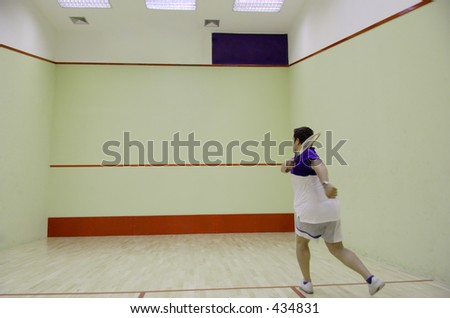 A person playing squash