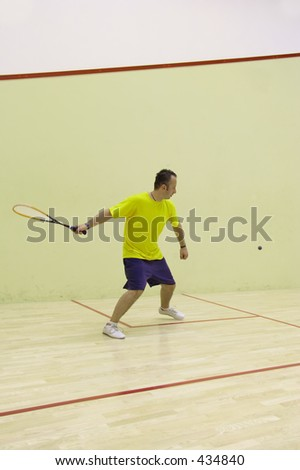 A person playing squash - stock photo