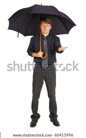 A person protected by a large umbrella from the rain - stock photo