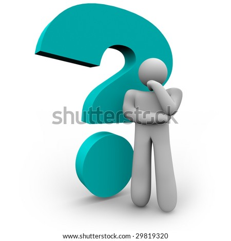 A person stands thinking beside a blue question mark - stock photo