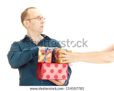 A person takes a gift from a business person