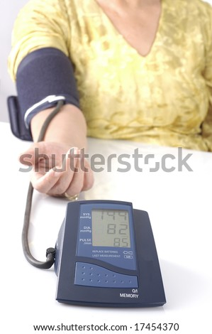 A person taking a home blood pressure test with selective focus - stock photo