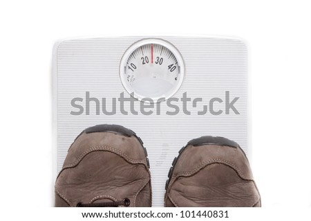 a person weighing themselves to know how many kilograms weight - stock photo