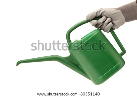 A person with gardening glove holding a watering can isolated on white background - stock photo