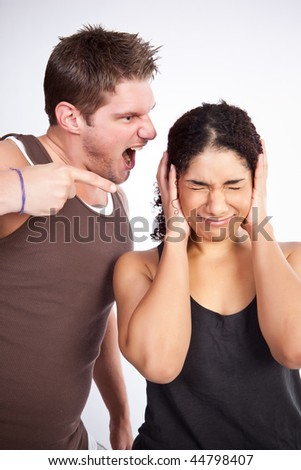 A personal trainer screaming at a woman - stock photo