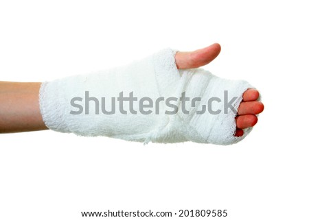 a persons hand wrapped in a gauze bandage. Isolated on white with room for your text. Gauze bandages are an important tool in the United States Health Care Industry as a cheap fix for sprains - stock photo