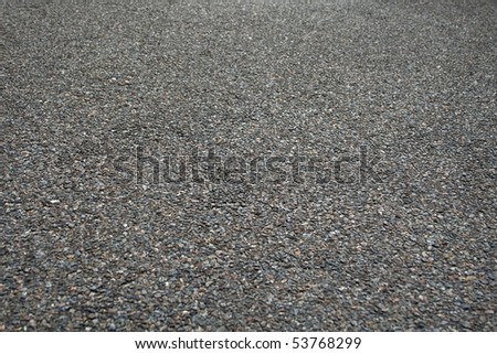 A perspective background texture of rough asphalt