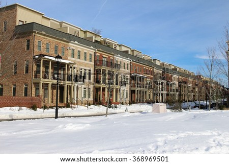 A perspective row of modern townhouses in the winter