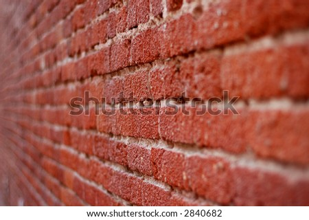 A perspective shot of a gritty brick wall - stock photo