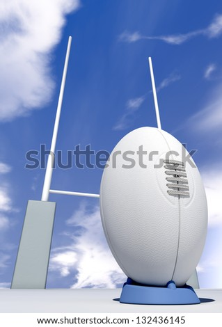 A perspective view of a plain white rugby ball on a blue kicking tee in front of some rugby posts on a blue sky background - stock photo