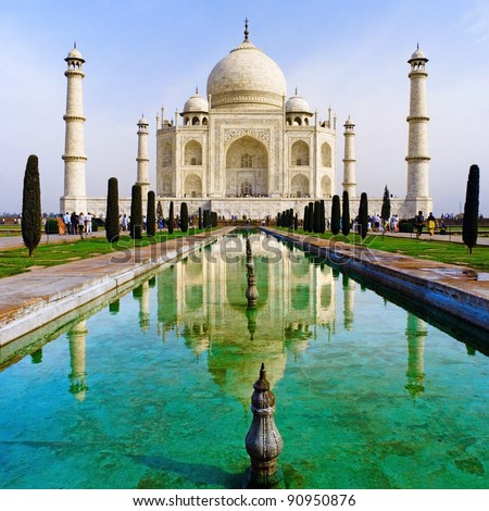 A perspective view on Taj-Mahal mausoleum with reflection in water. - stock photo