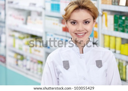 A pharmacist in a pharmacy in uniform