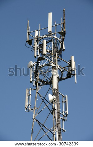 A phone mast against a clear blue sky