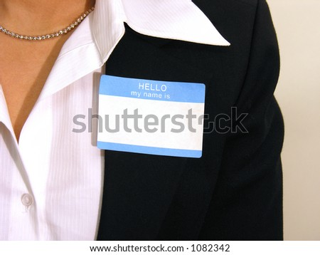 A photo of a business woman with a name tag