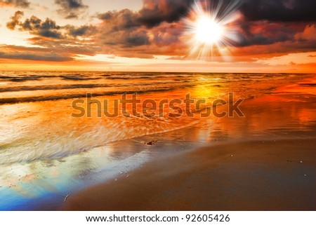 A photo of  a Calm ocean at sunset