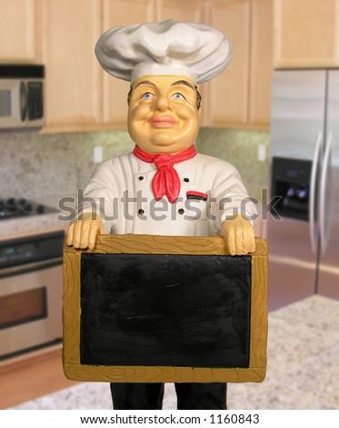 A photo of a chef statue holding a menu board - stock photo