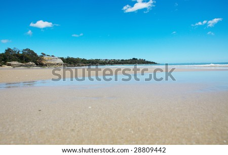 a photo of a clam and empty beach - stock photo