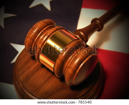 A photo of a gavel on the American flag - stock photo