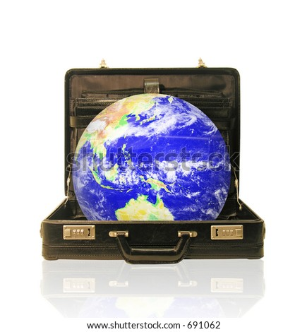 A photo of a globe coming out of a briefcase with a global business theme - stock photo