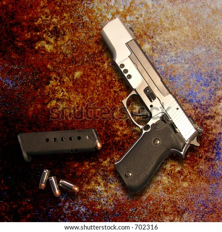 A photo of a gun on a rustic surface - stock photo