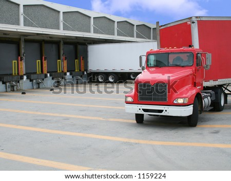 A photo of a loading and unloading warehouse - stock photo